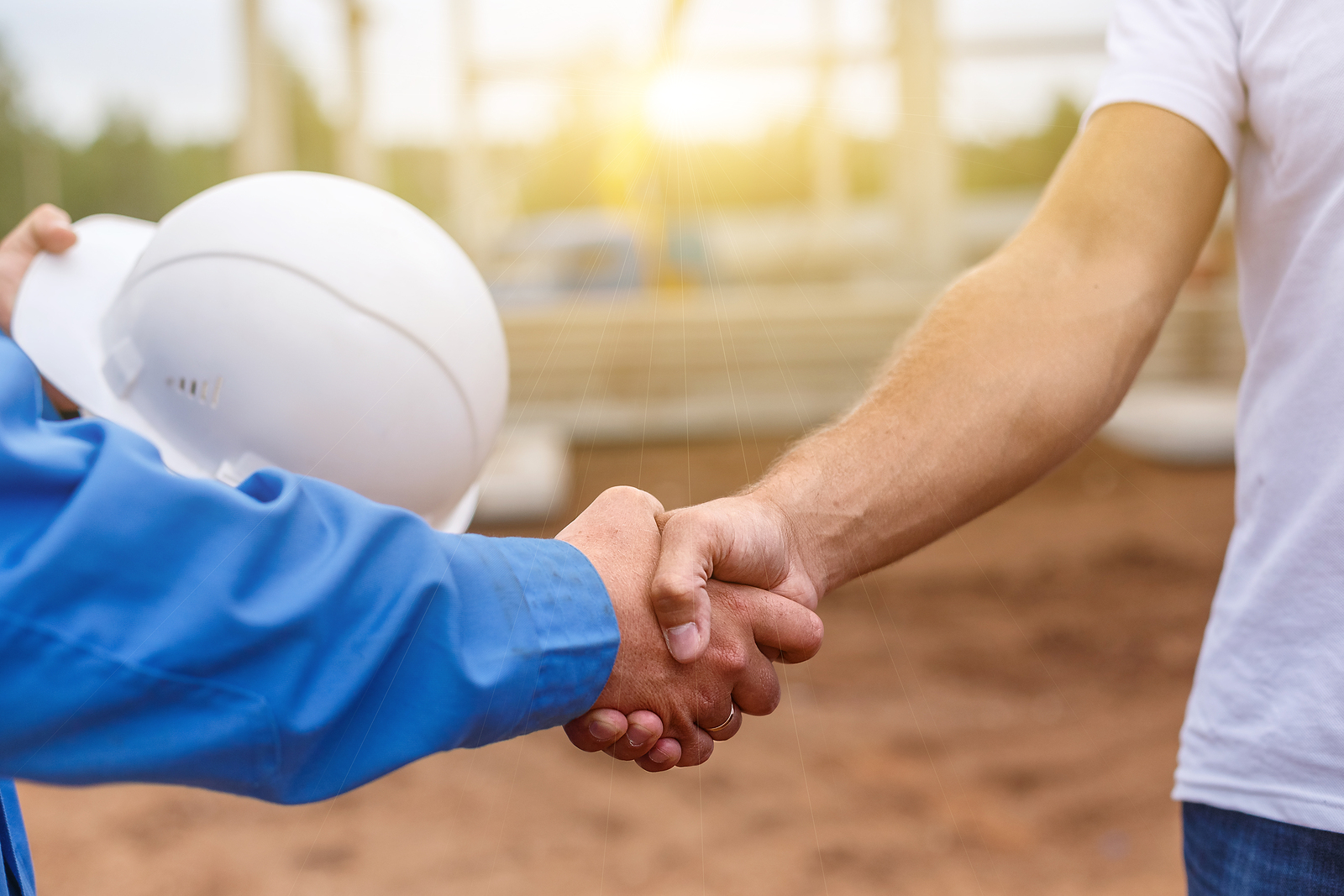 bigstock-builders-shaking-hands-118252484